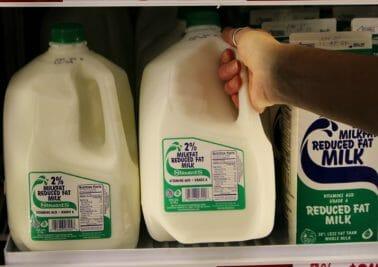 hand grabbing milk