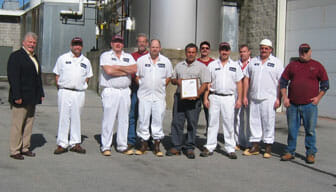 Stewart's Employees Outside with award