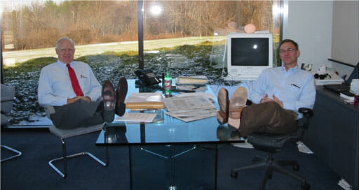 Image of Bill and Gary Dake in the office