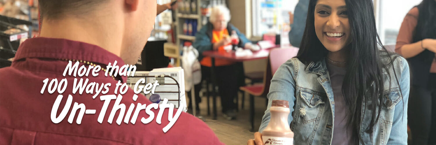 Girl buying a chocolate milk refresher from a Stewart's partner