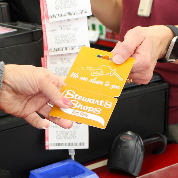 customer handing employee gas card