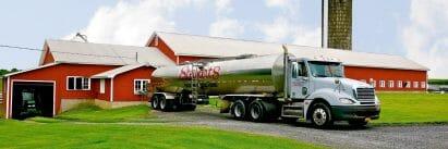 Stewart's truck picking up milk at farm