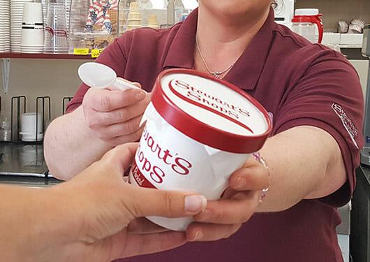 partner handing customer hand packed pint