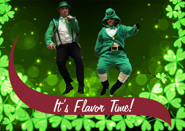 Two managers jumping wearing green