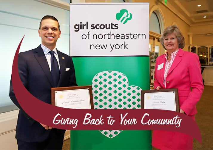Susan Dake receiving honorary gold award from girl scouts