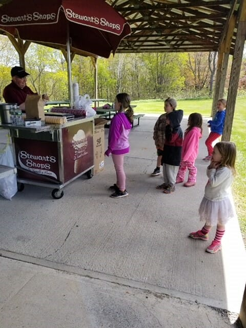 Kids lined up to get ice cream