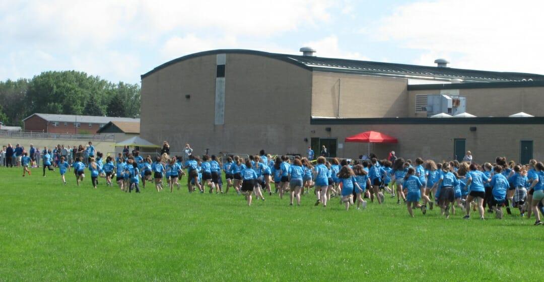 Fun Run kids in blue shirts