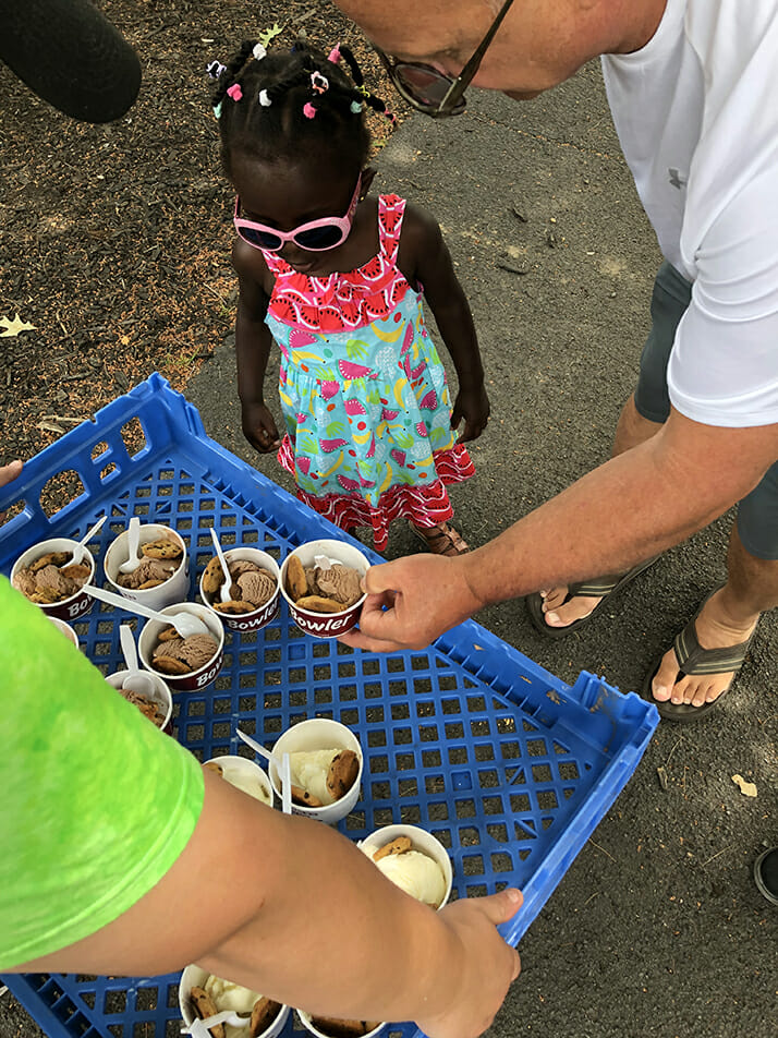 little girl and ice cream and cookie handout