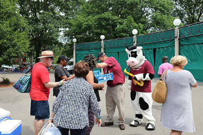 flavor mascot and partner giving away ice cream to customers