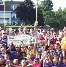Johnstown Check Presentation with group of people