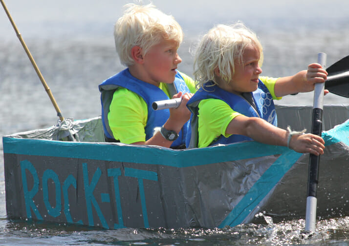 two kids boating