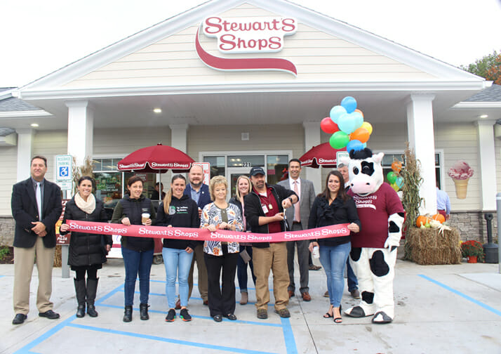 ribbon cutting with partners and flavor in front of shop