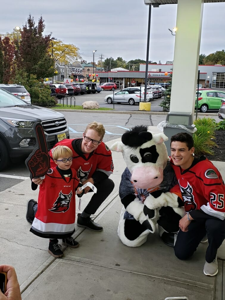 hockey players with flavor mascot