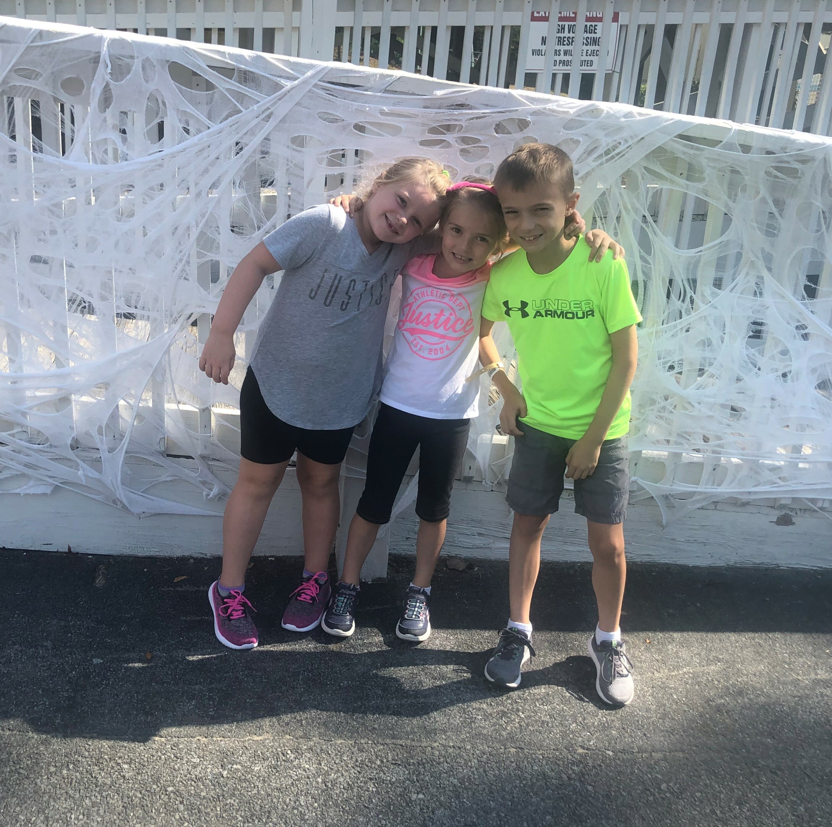 3 little girls posing by cobwebs