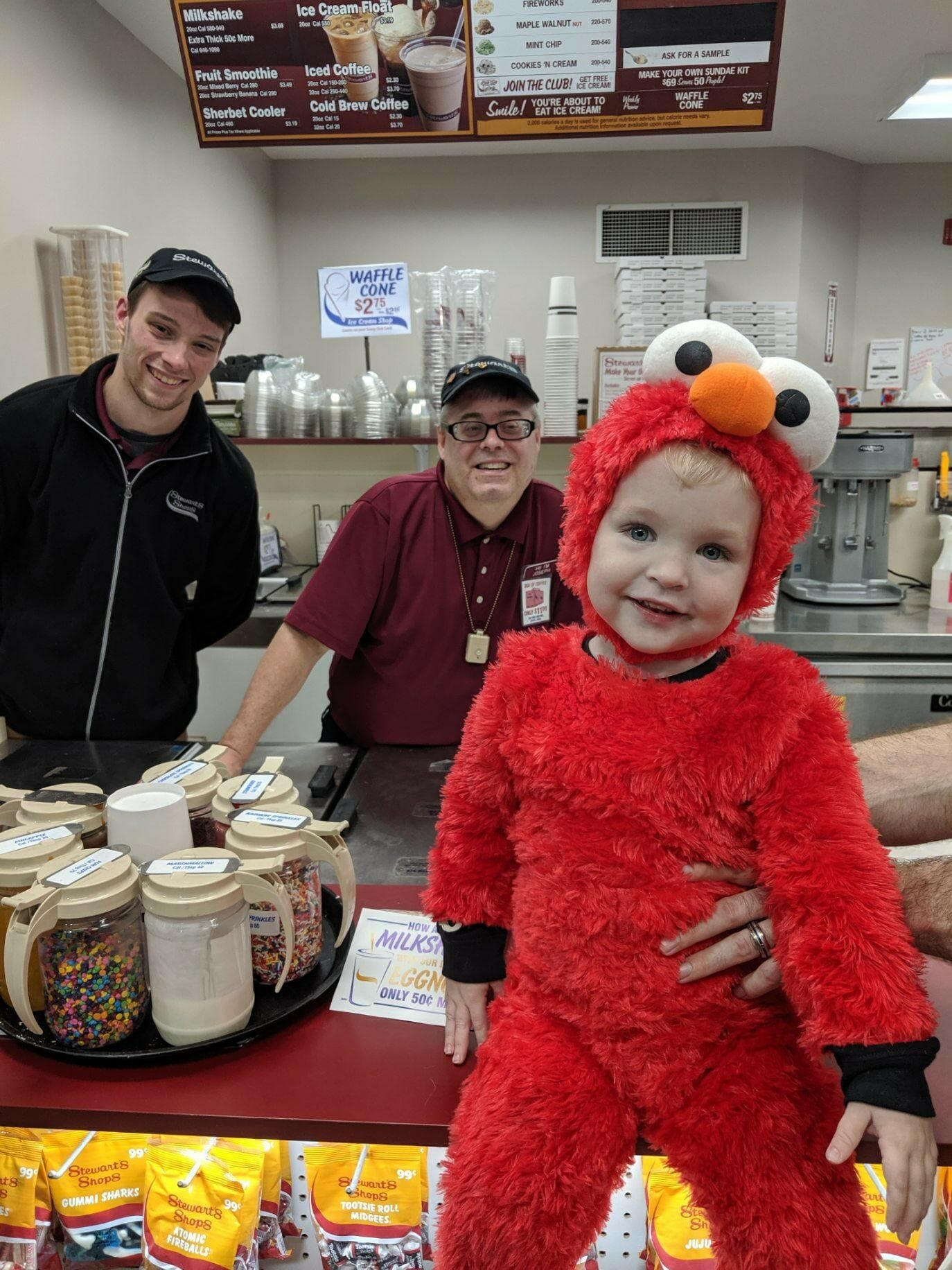 stewarts partners and little one in elmo costume