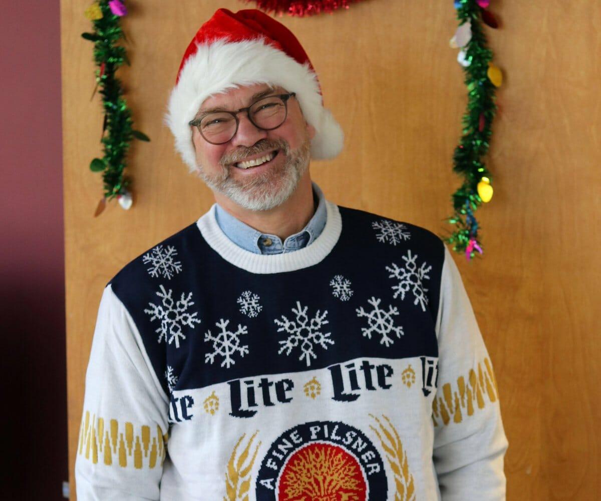 Gary Dake wearing Miller/Coors ugly sweater