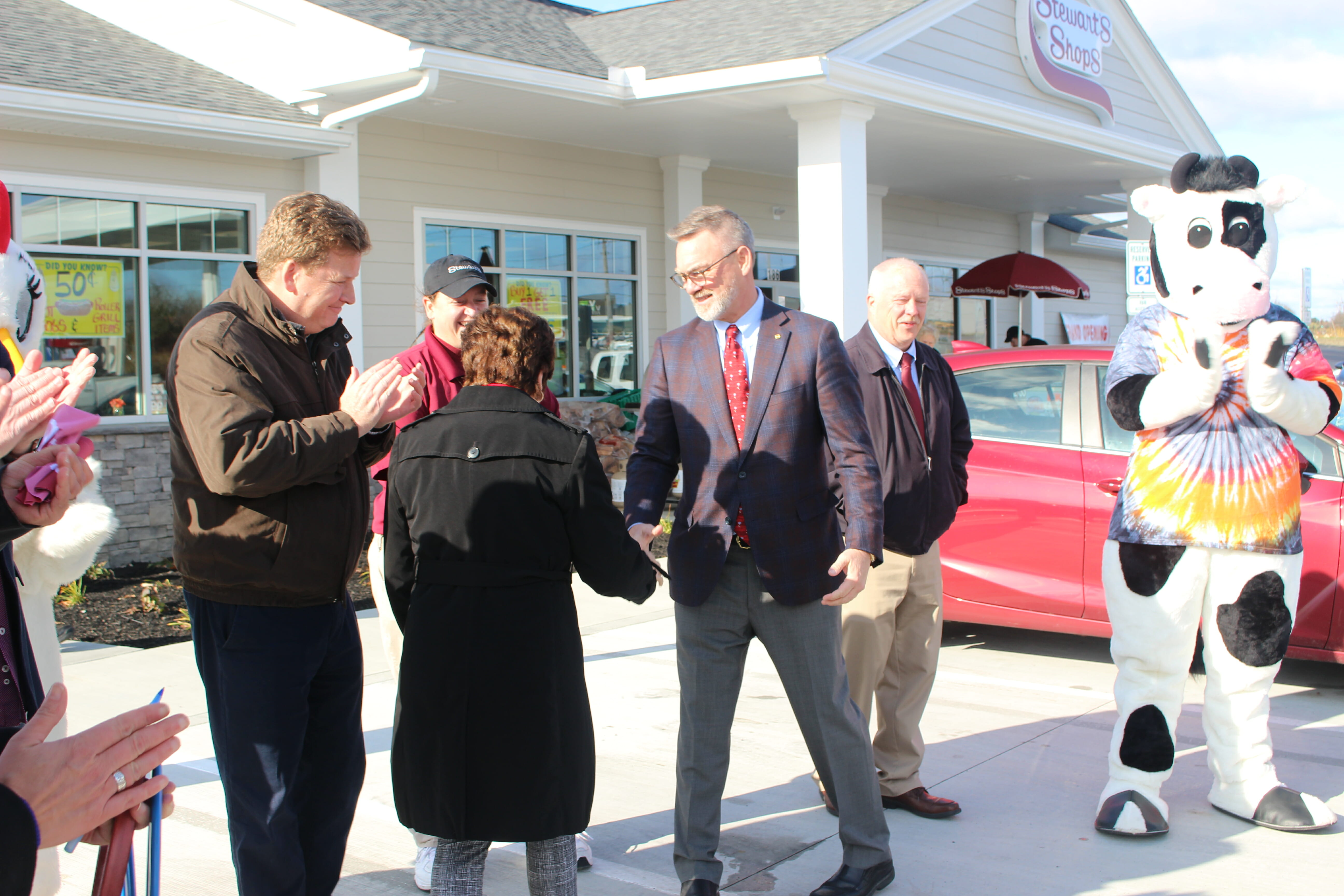 Gary Dake shaking hands with an official at the grand opening event
