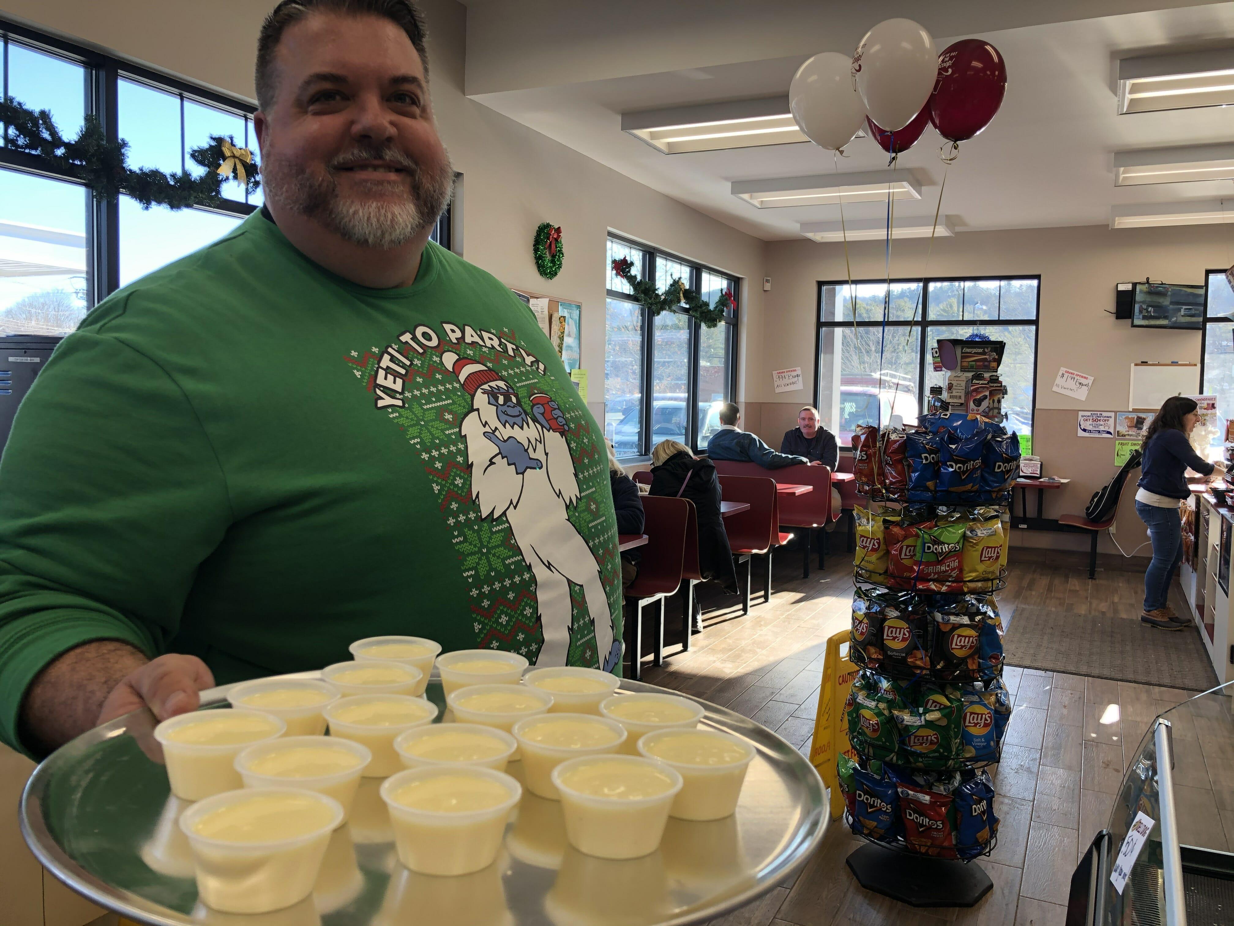 a stewarts district manager sampling eggnog
