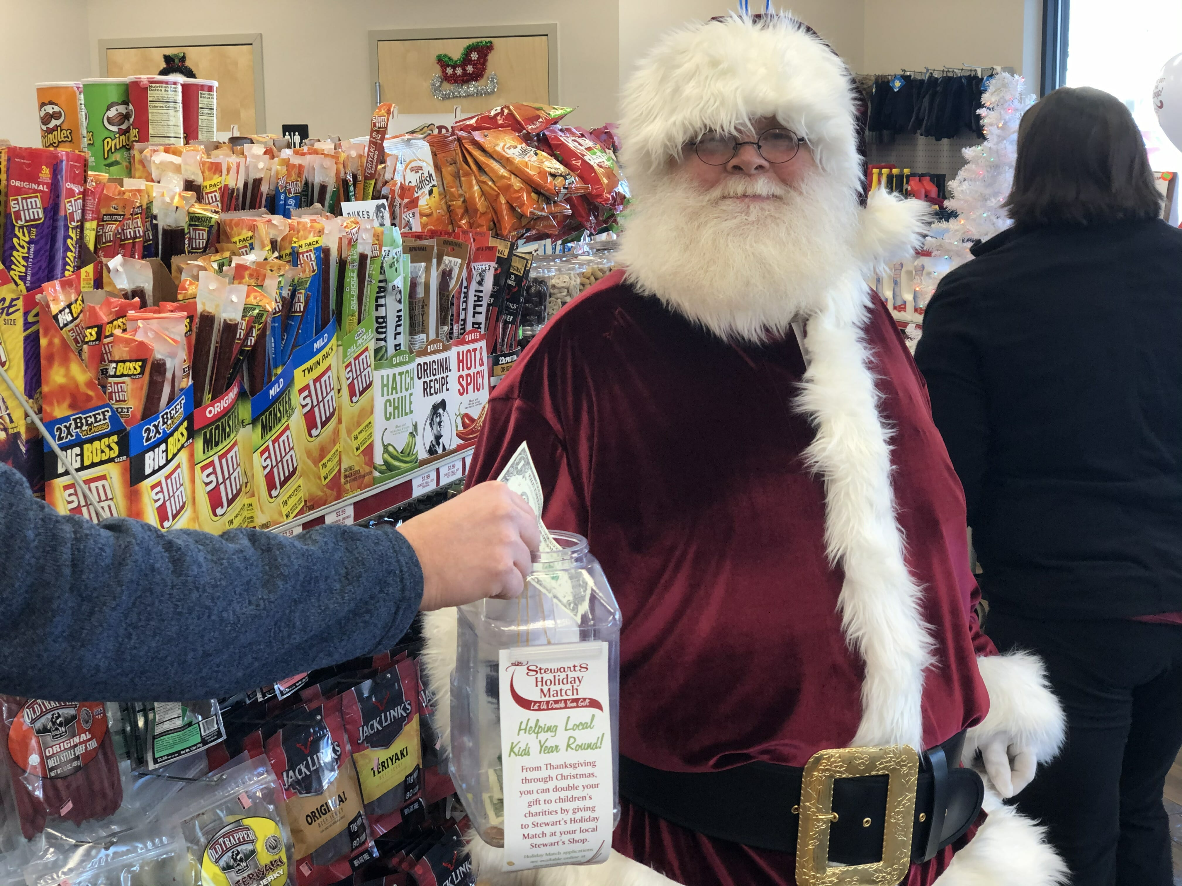 Santa collecting money for Stewarts Holiday Match