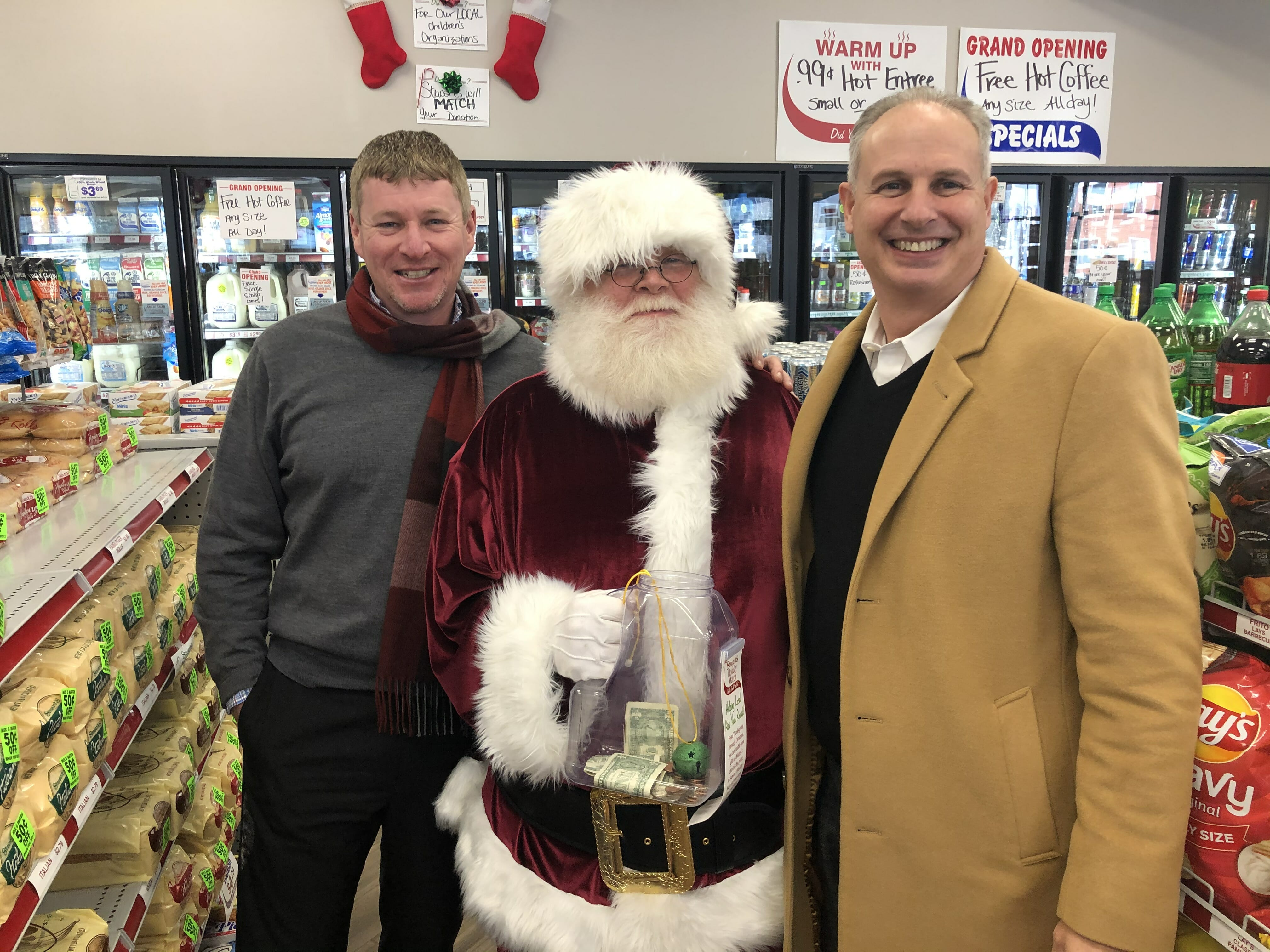 Two stewarts employees and Santa