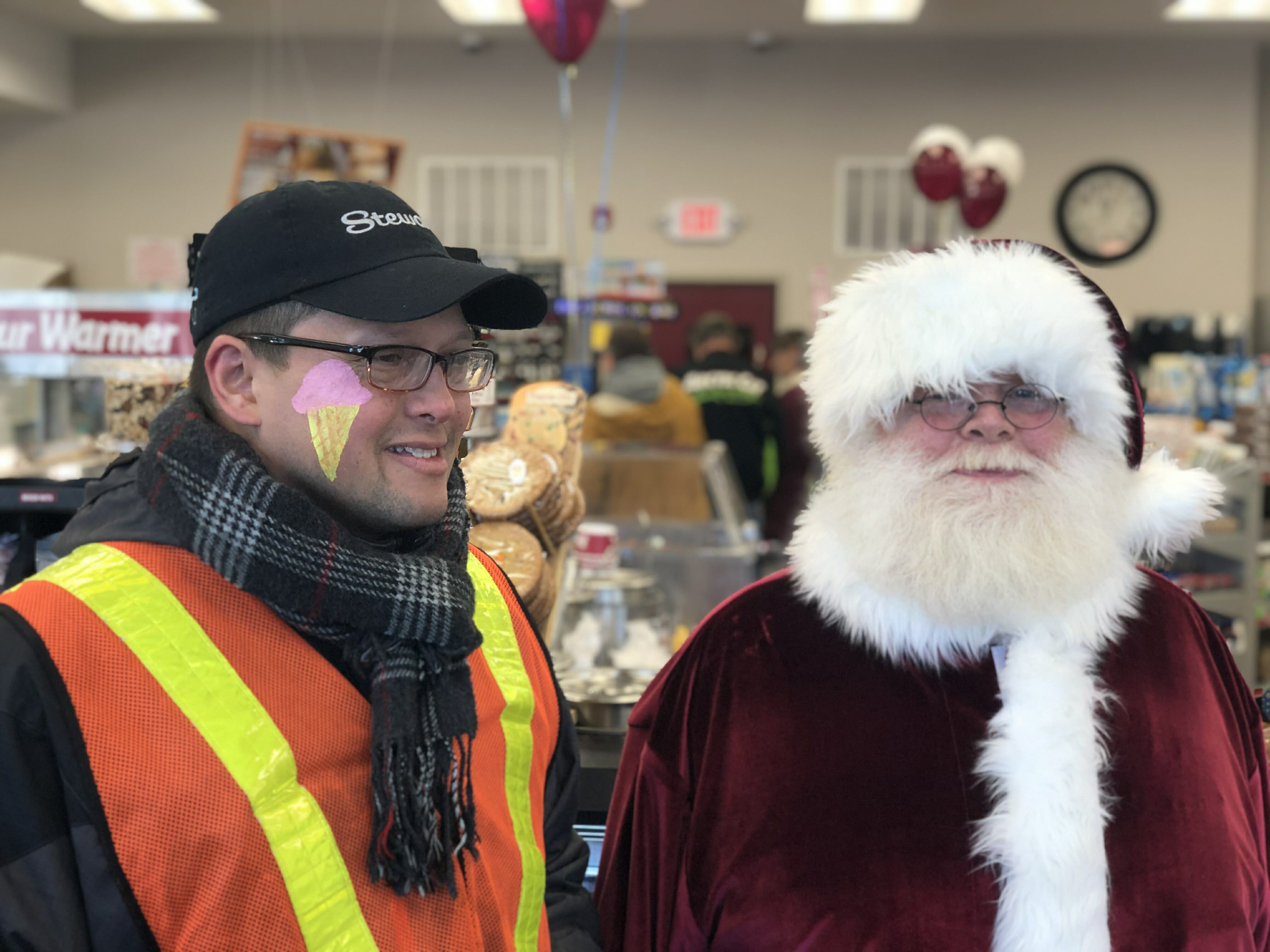 santa and a stewarts employee with face paint of an ice cream cone