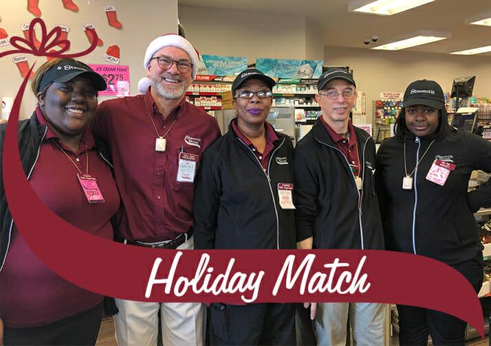 Holiday Match Group shot of Partners with Stewarts president Gary Dake
