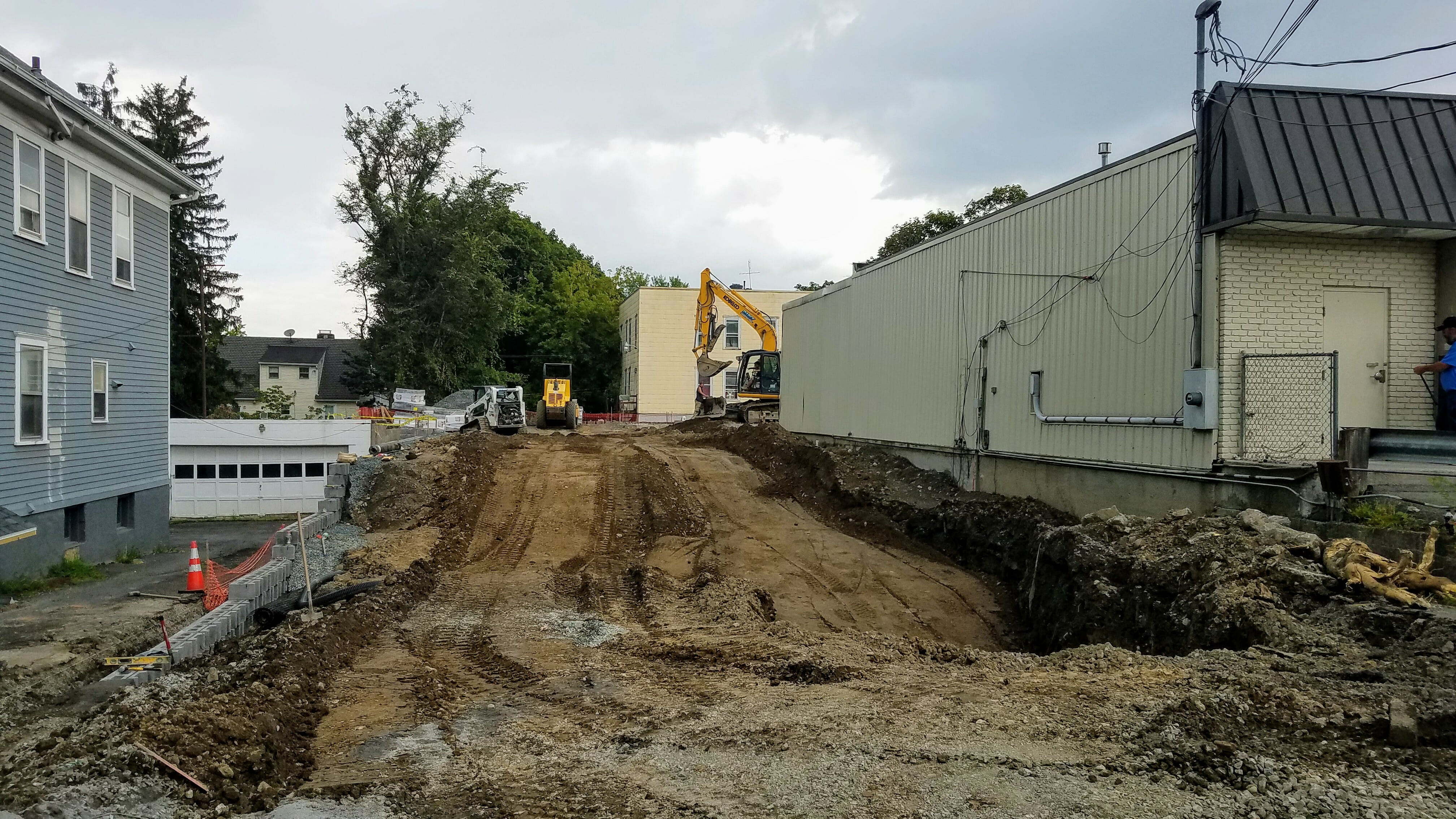dirt being moved next to shop