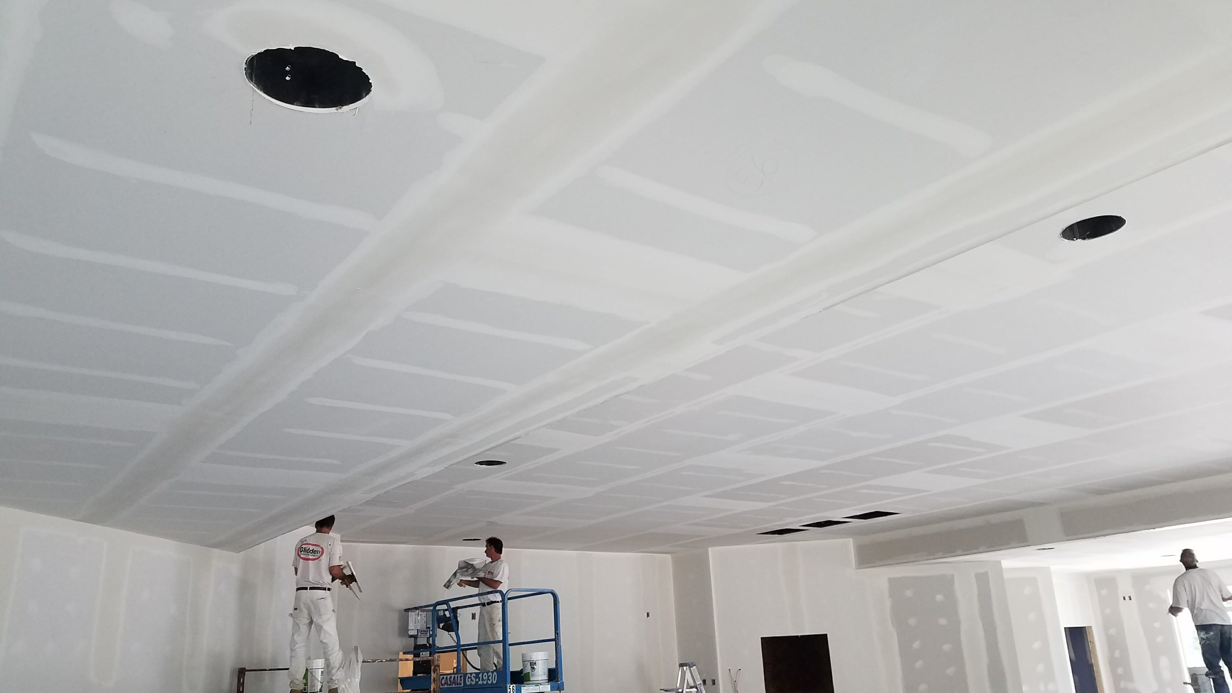 ceiling of new shop being taped and mudded