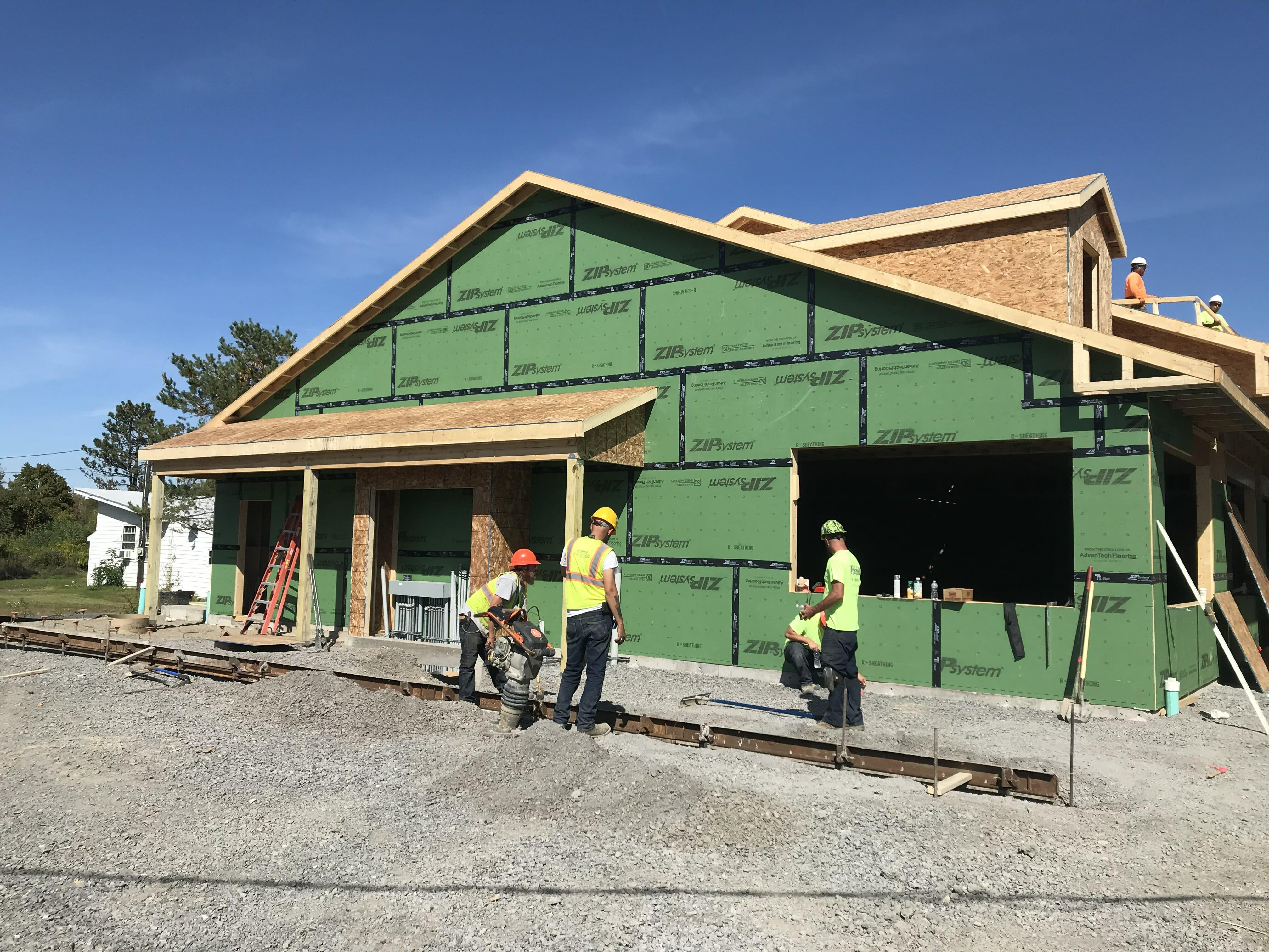 construction workers building shop