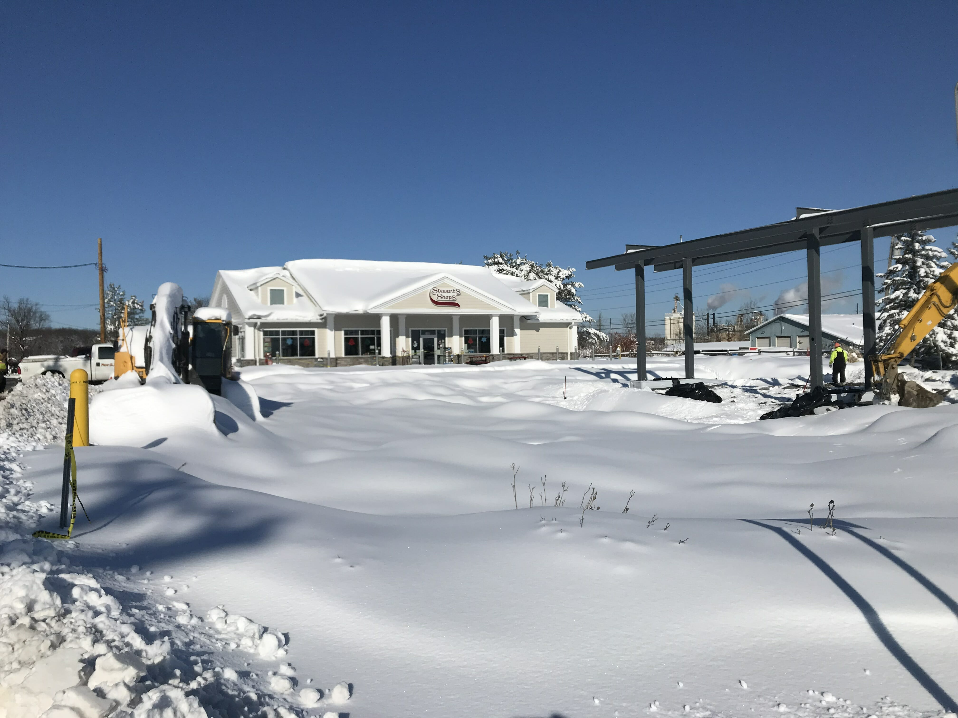 snowy lot in front of new shop