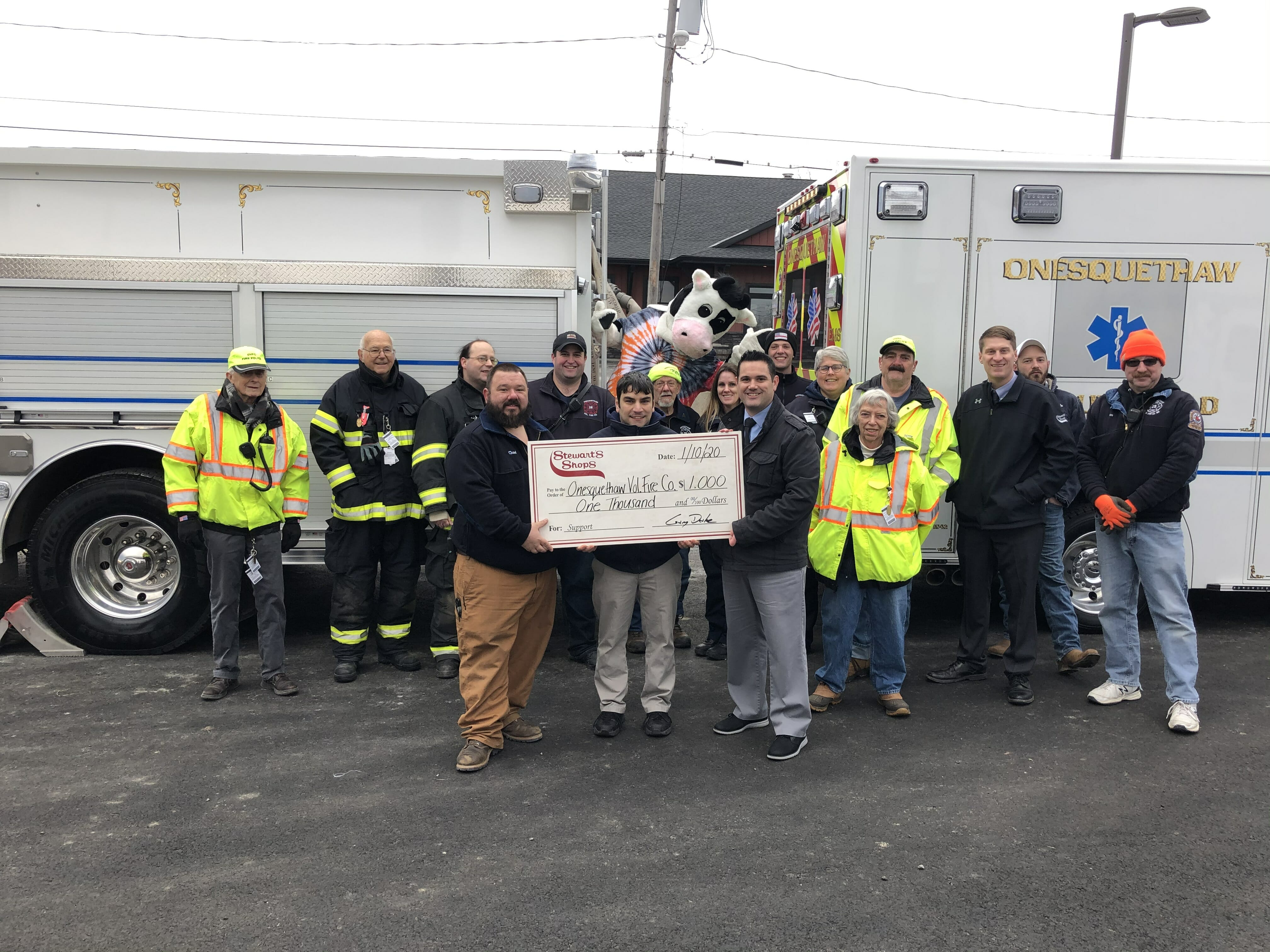 Check presentation to the fire station with a group of people and flavor the cow