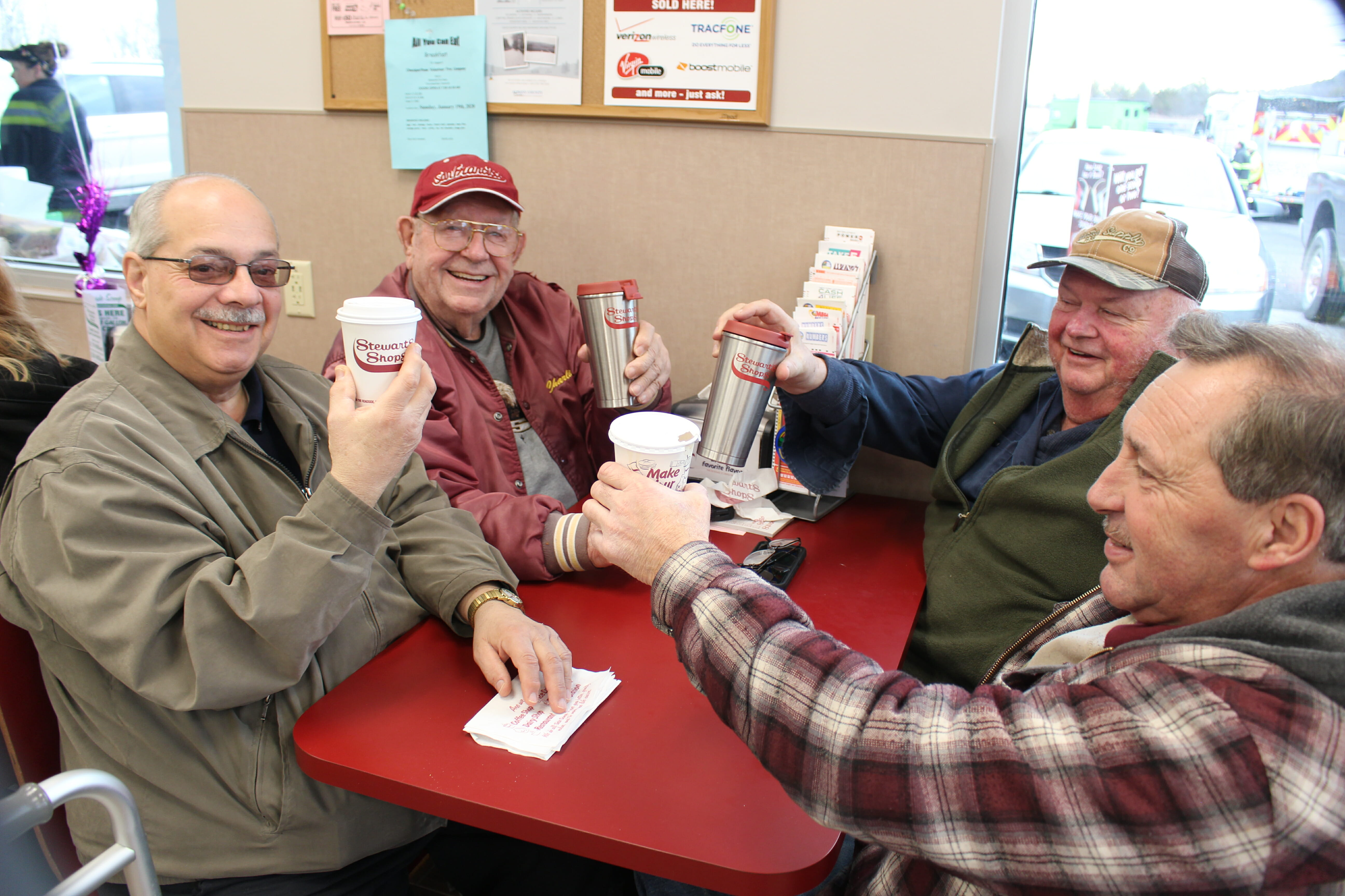 4 men having coffee at Stewarts during the grand opening