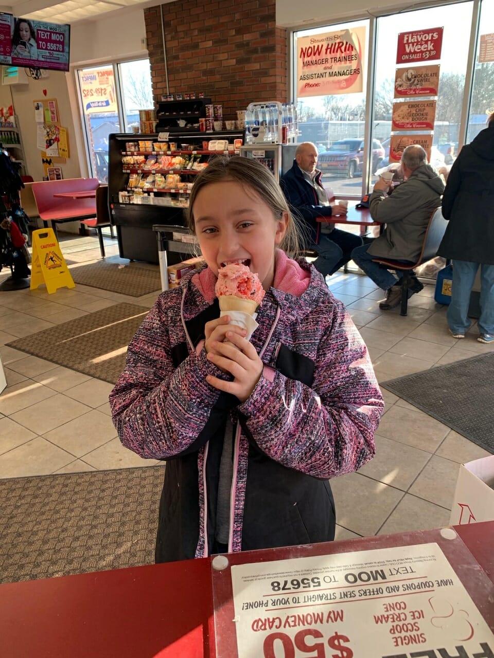 A young girl having an ice cream cone