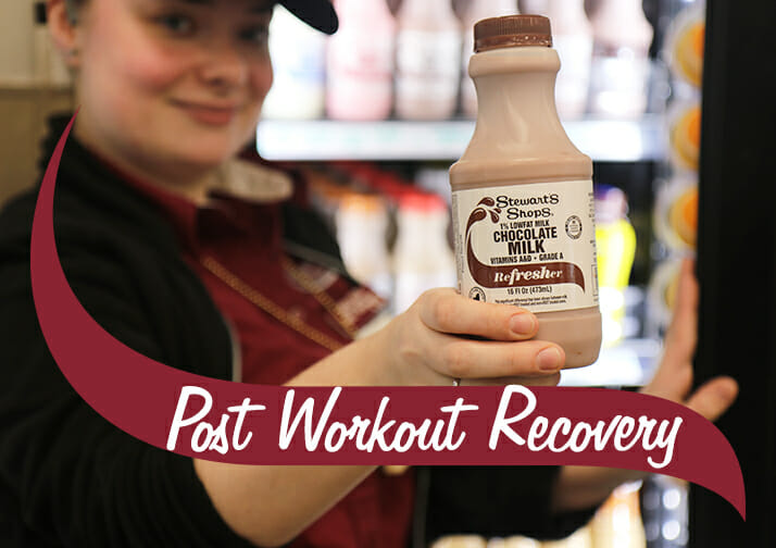 Post workout Recovery. Stewarts chocolate milk refresher held by a Strewarts partner