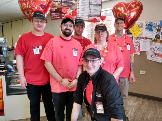 A group of Stewarts partners dressed for valentines day