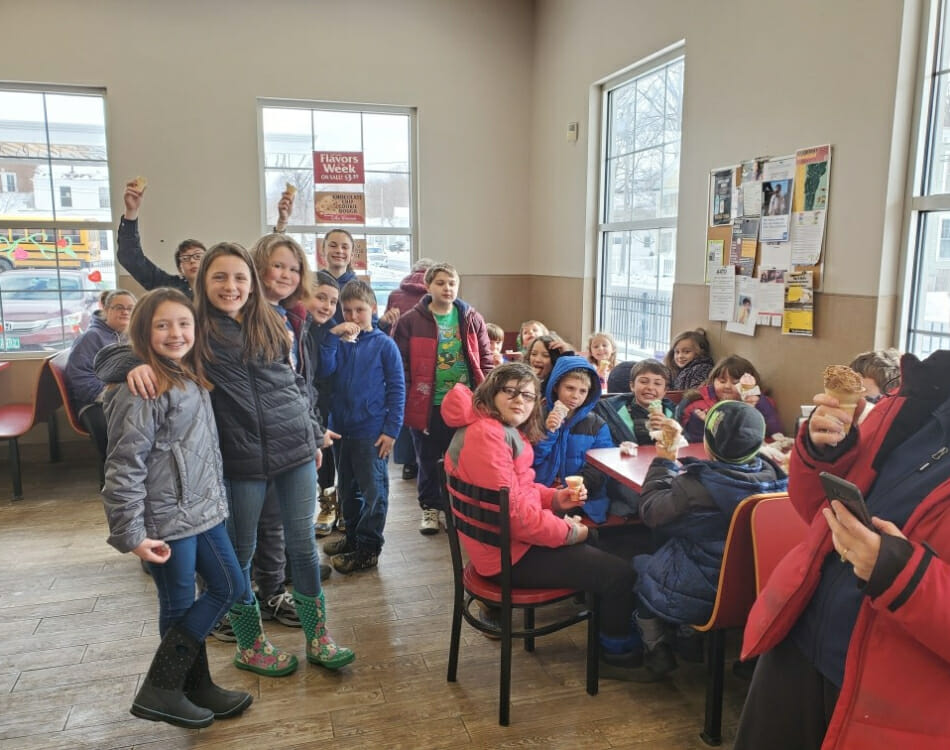 A class of children having ice cream at a Stewarts