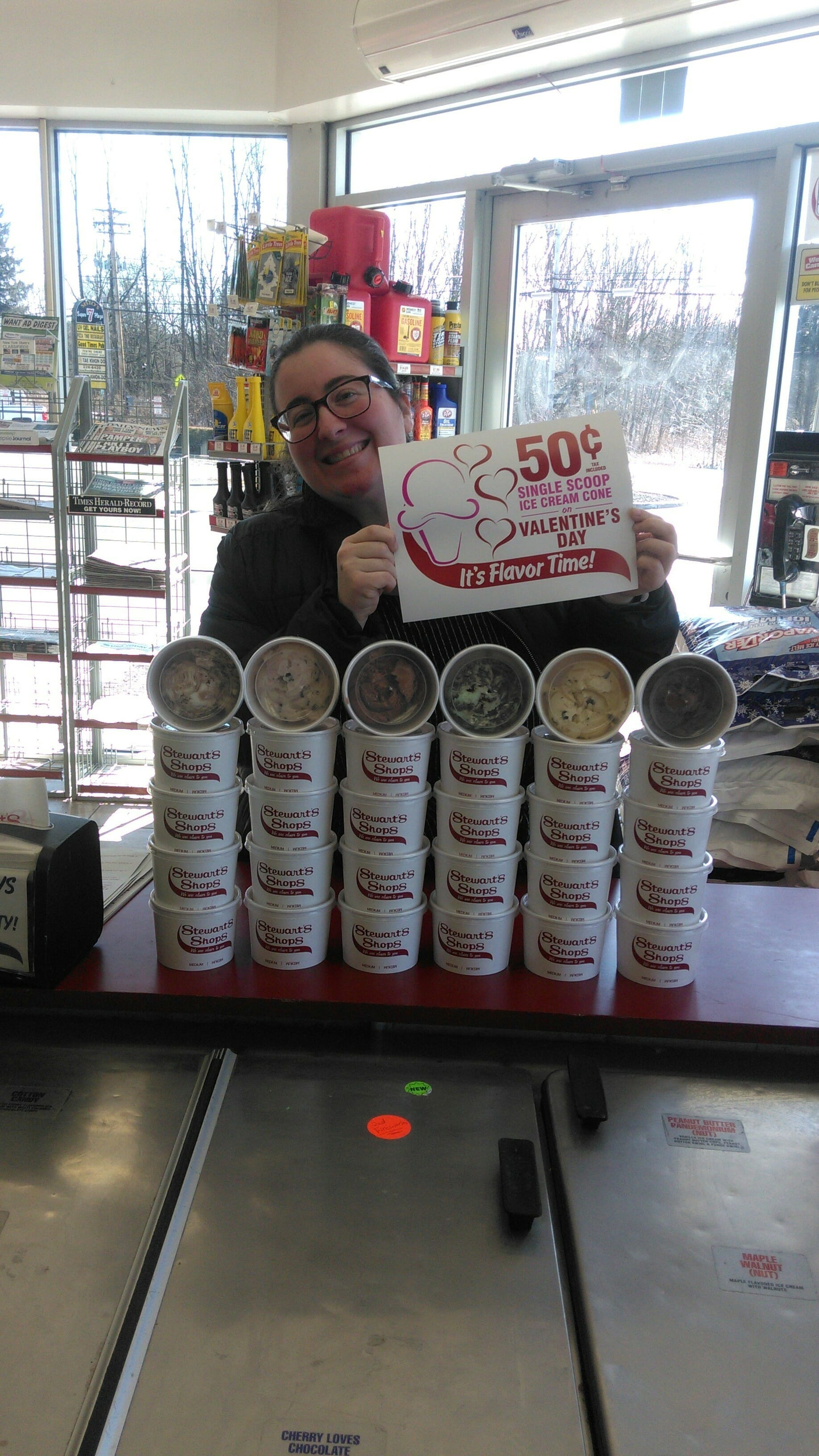 A woman hold a sign at Stewarts shops - 50 cents valentines cones