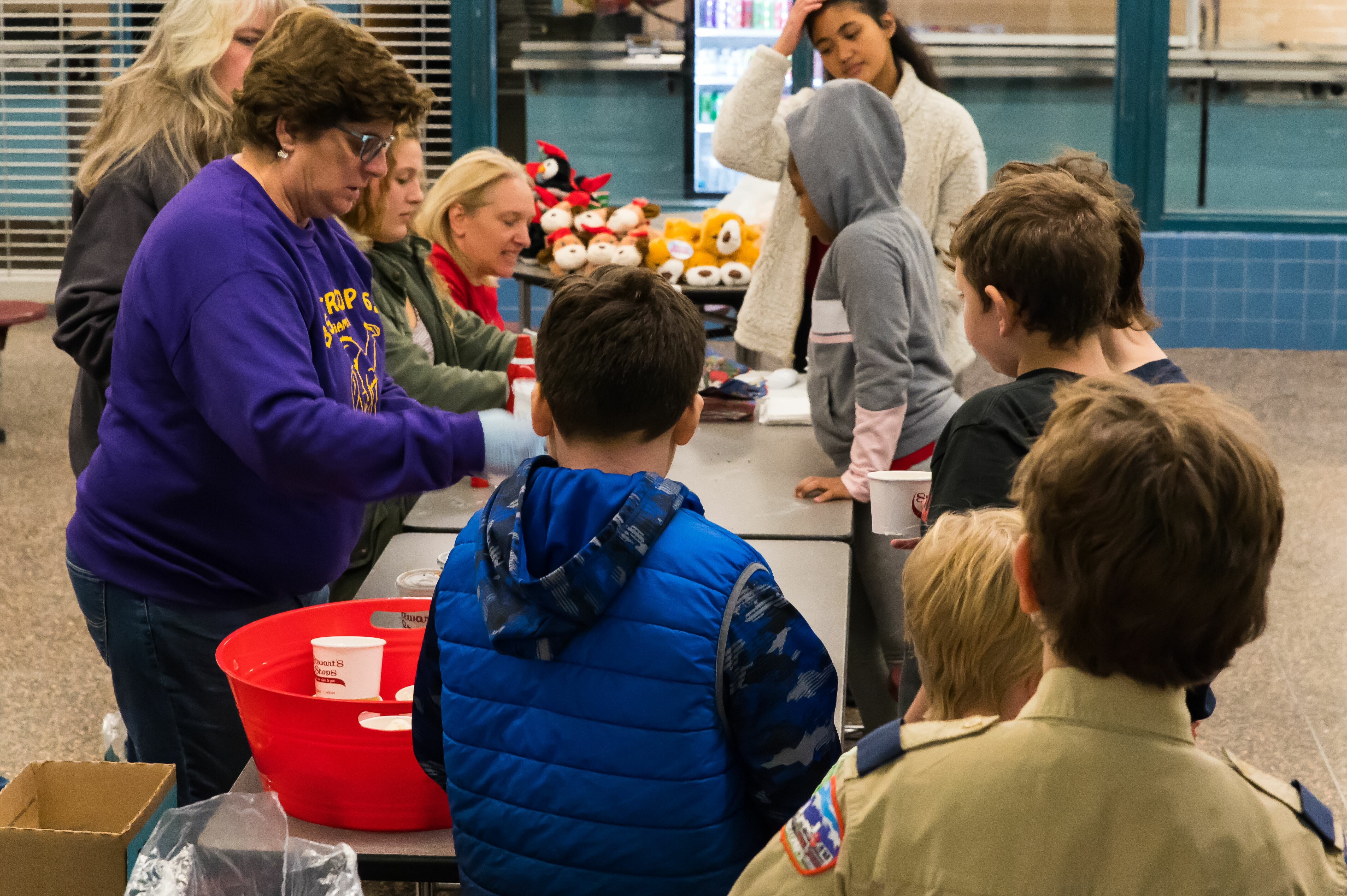 Boy scout Troop scooping ice cream.