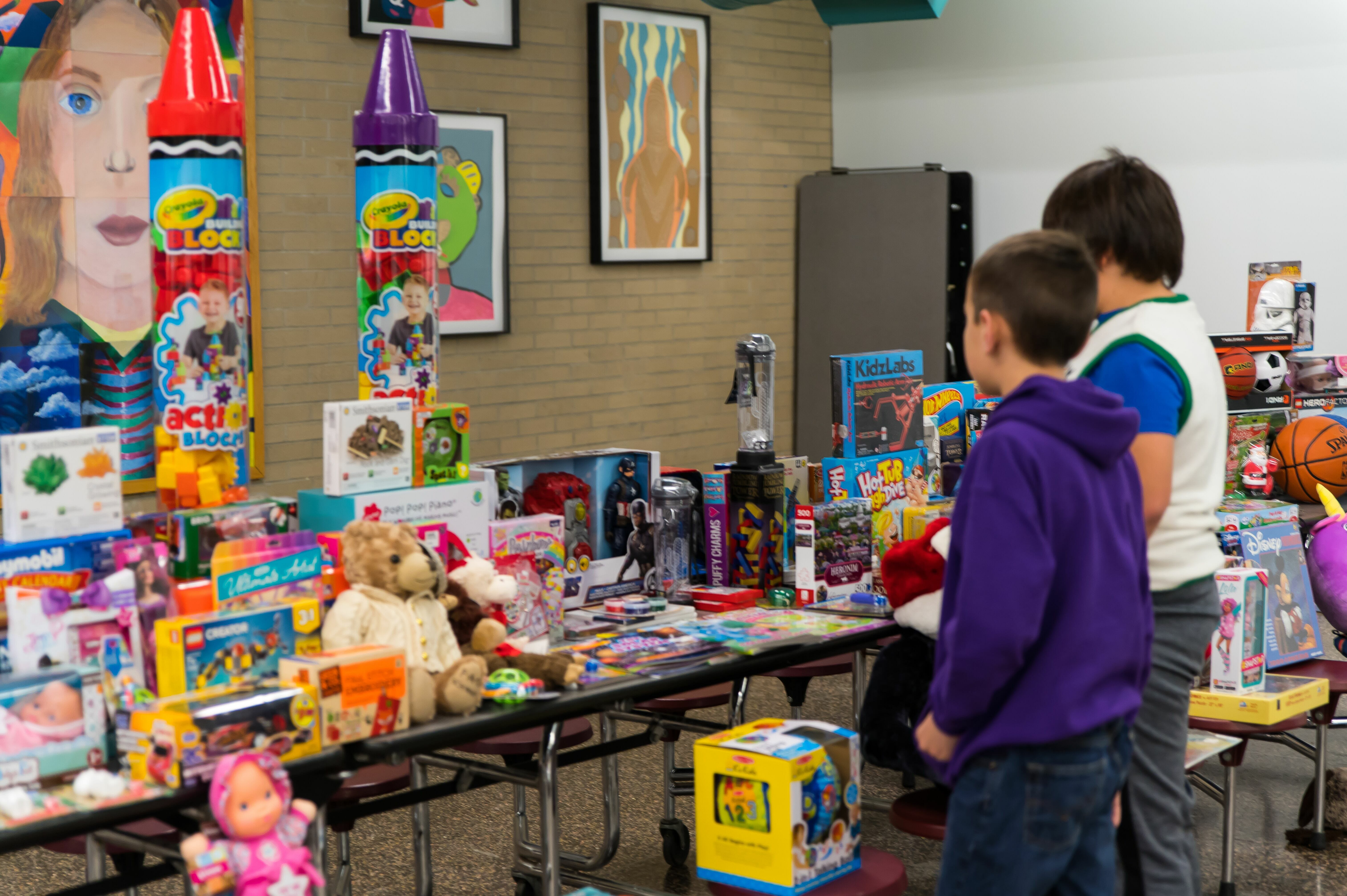 Two boys look at holiday presents for St. Catherine's children.