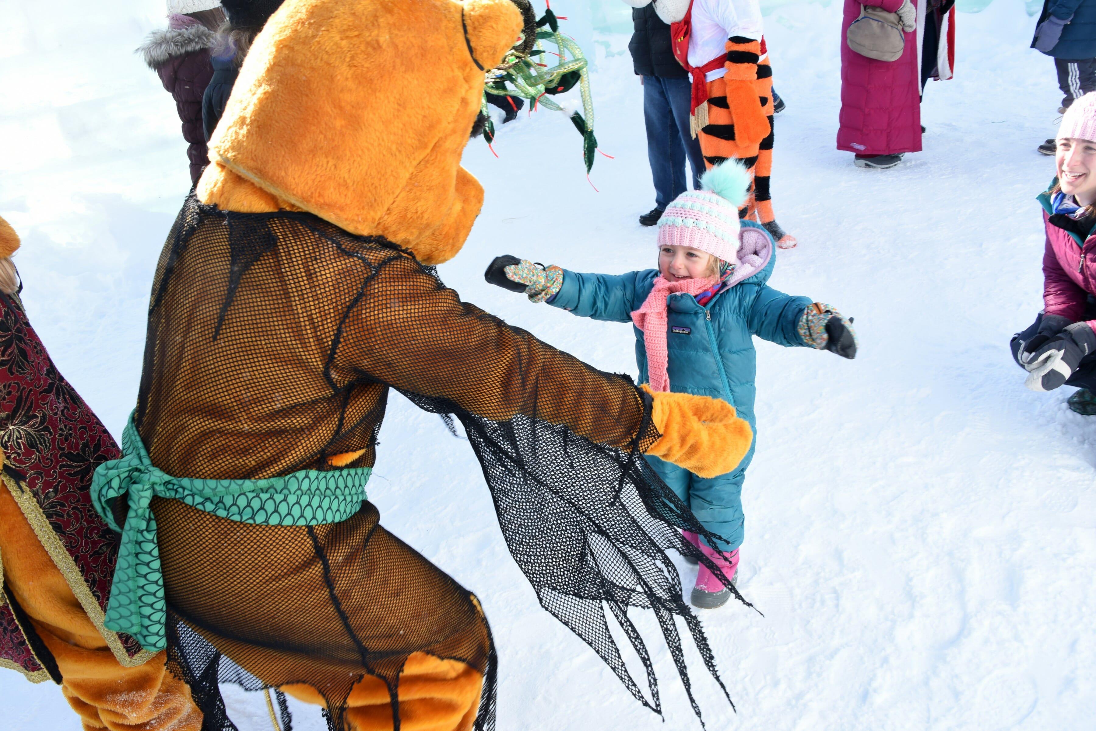 Child greeted by a costumed character.