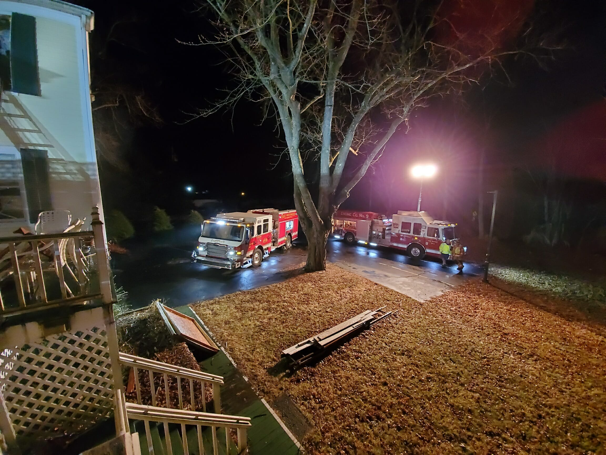 two fire trucks outside at night.