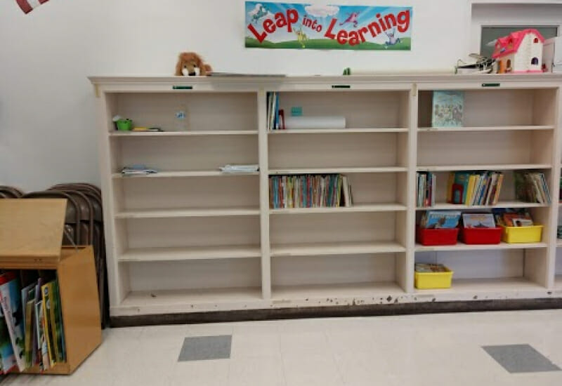 Mostly bare library shelves.