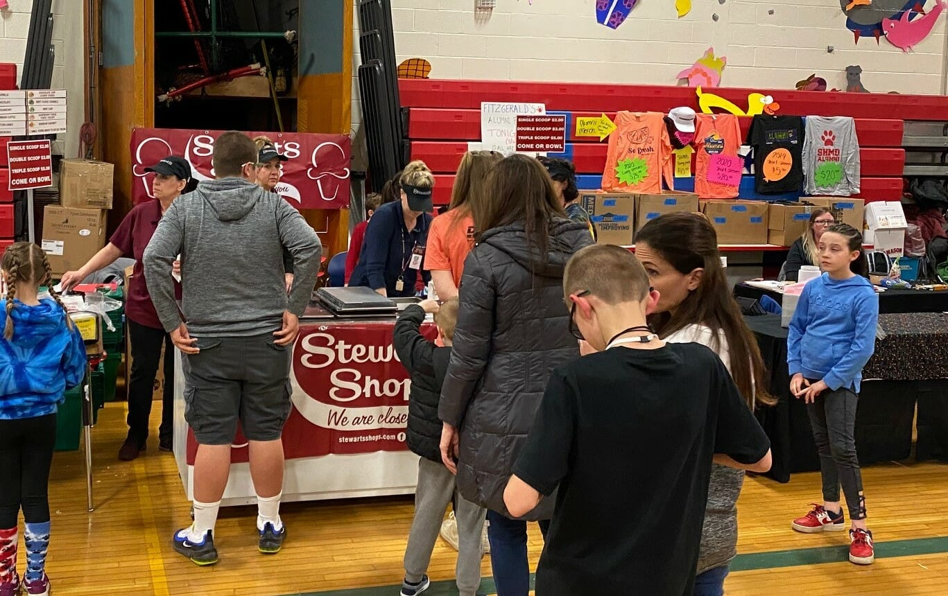 Line of school supporters getting ice cream.