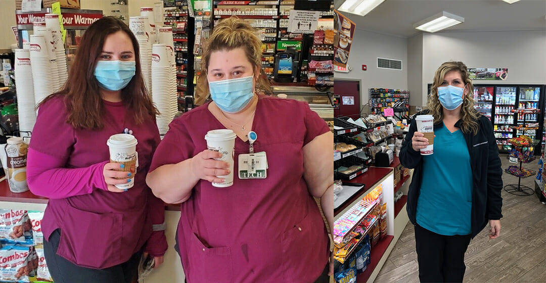 medical professionals with coffee and masks