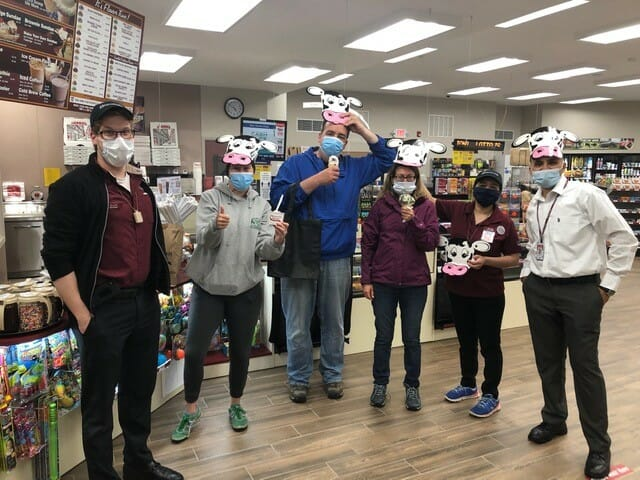 customers and employees in cow masks