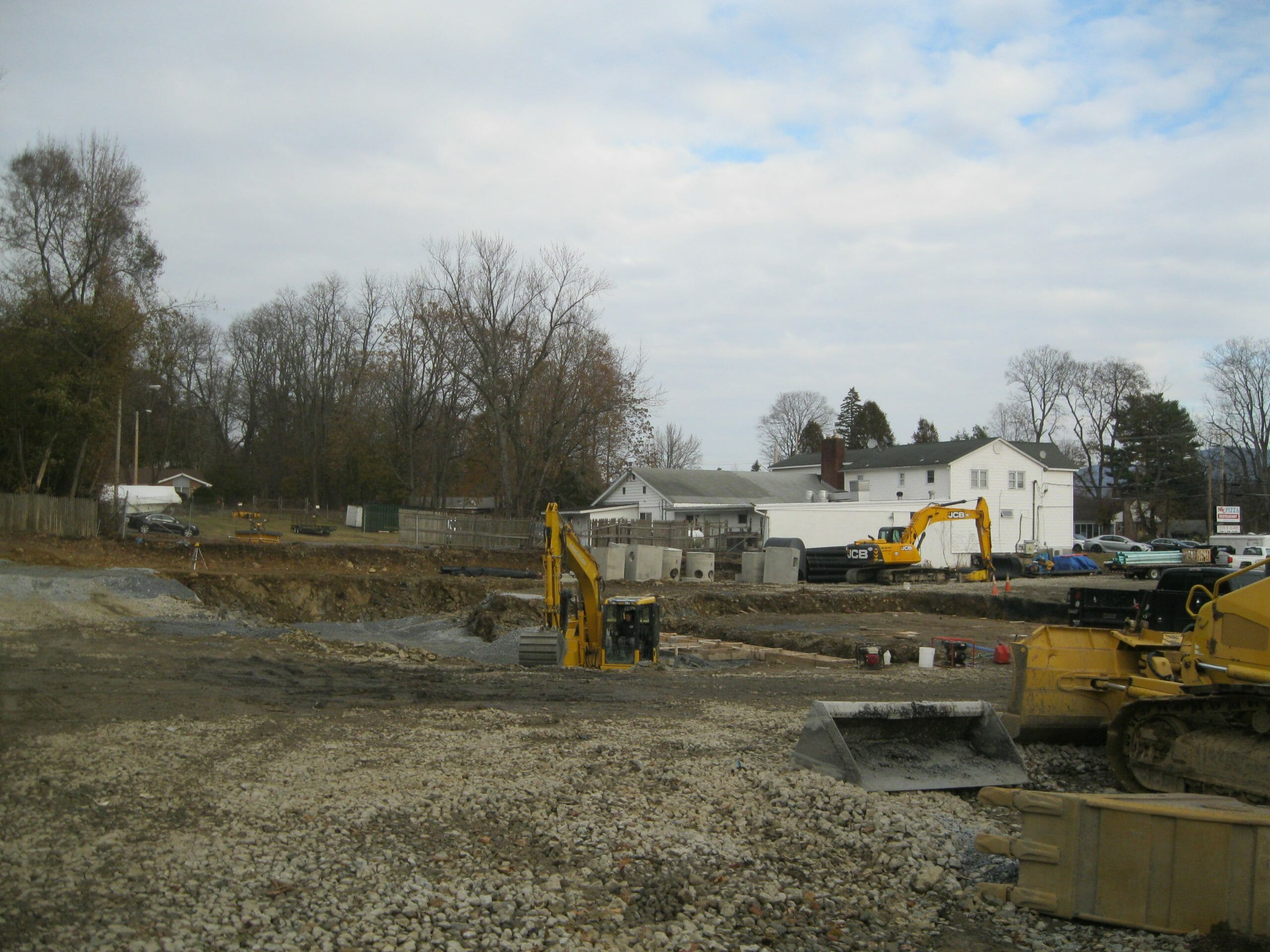Heavy machinery working on lot