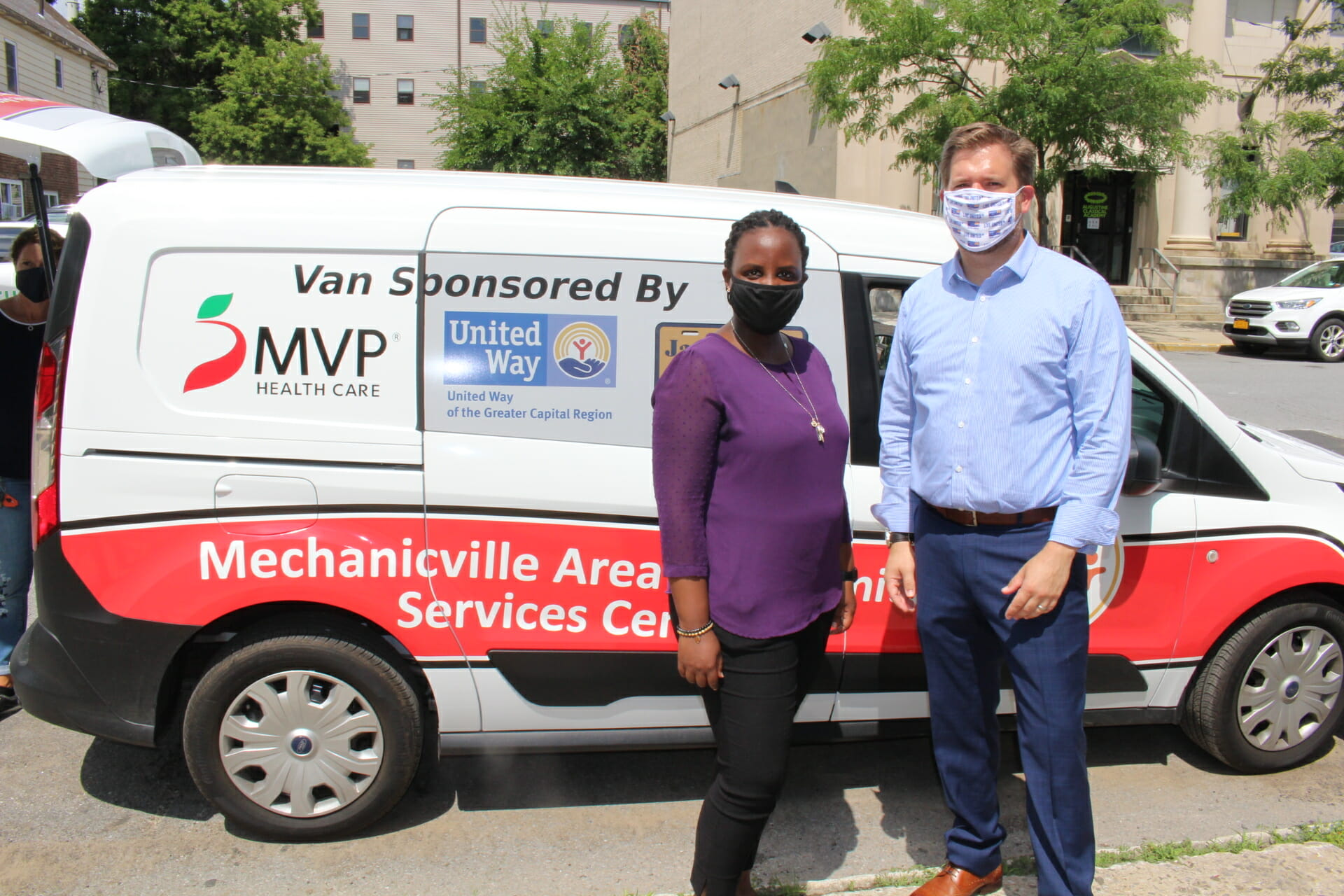 United Way CEO with meal delivery van
