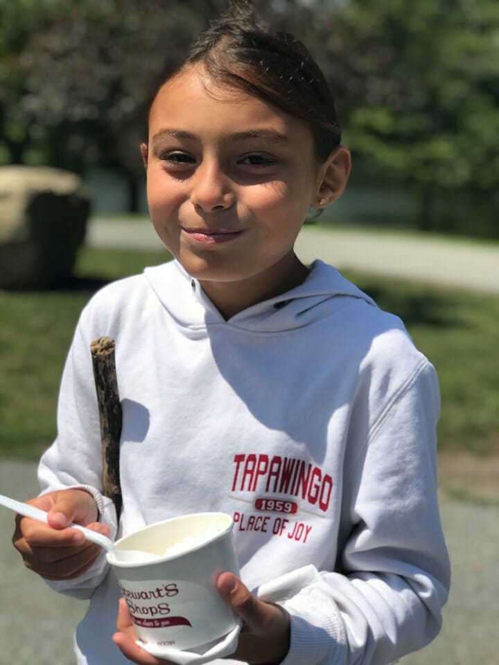 Camper eating ice cream out of a dish