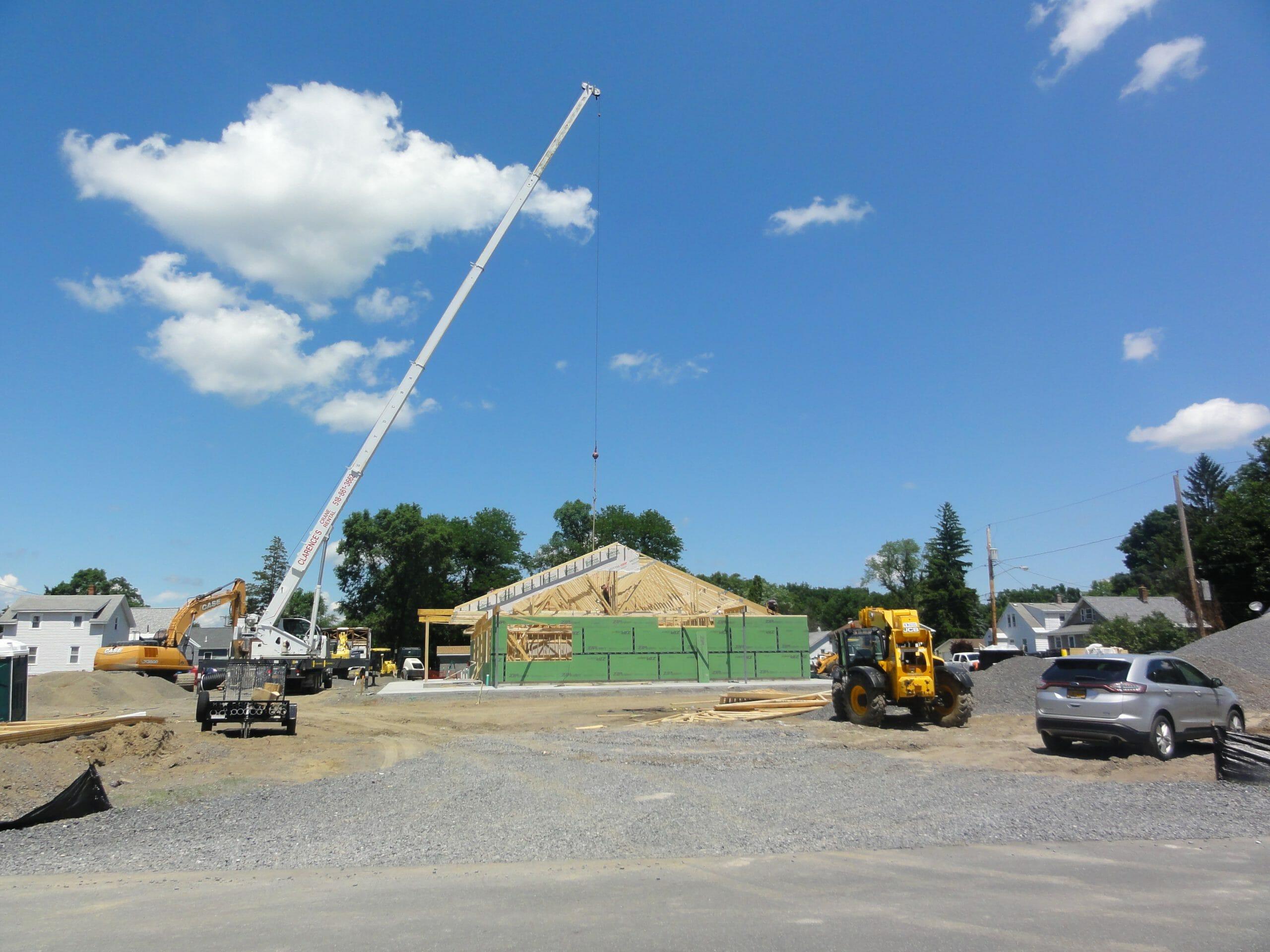 crane adding trusses to shop