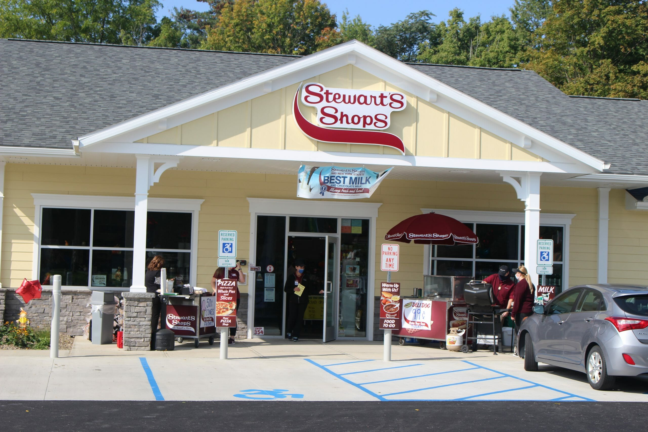 Stewarts shop with a best milk banner and two carts by the front door